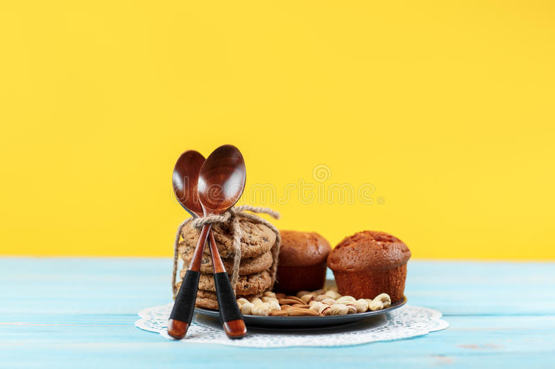 Chocolate muffins on yellow and blue vintage background royalty free stock photos