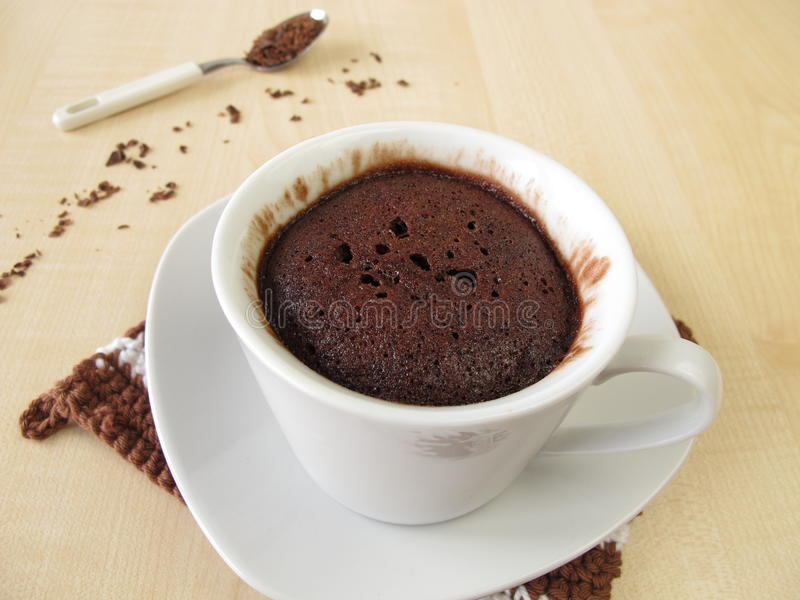 Chocolate mug cake in cup stock image