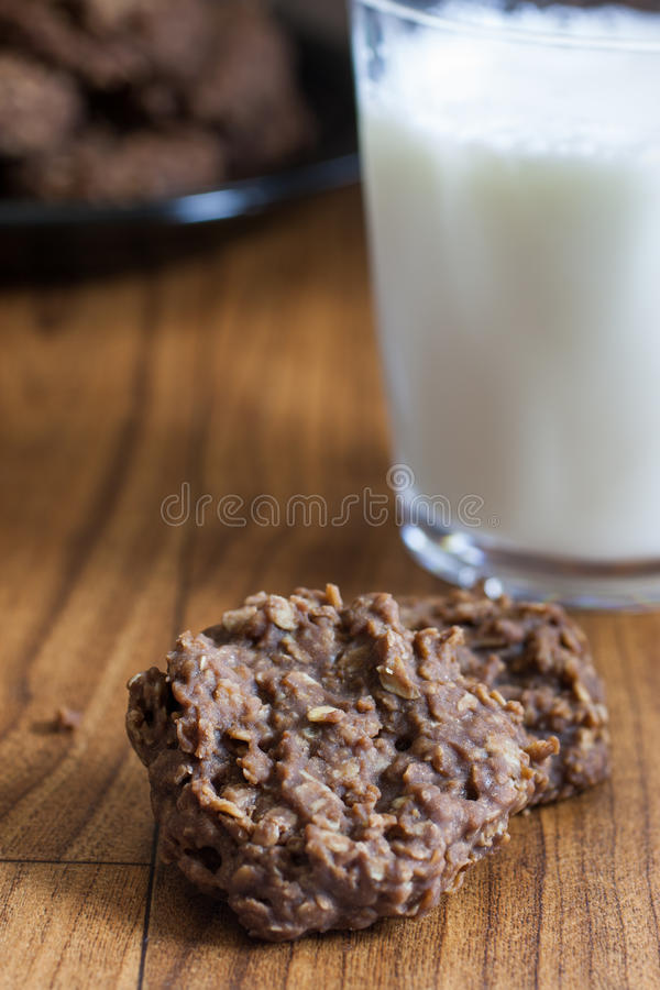 Chocolate No-Bake Cookies. On a table with a glass of milk, illuminated but sunlight coming oin from the right side royalty free stock image