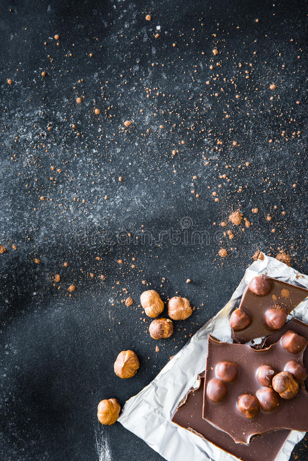 Chocolate and nuts on black table stock photo