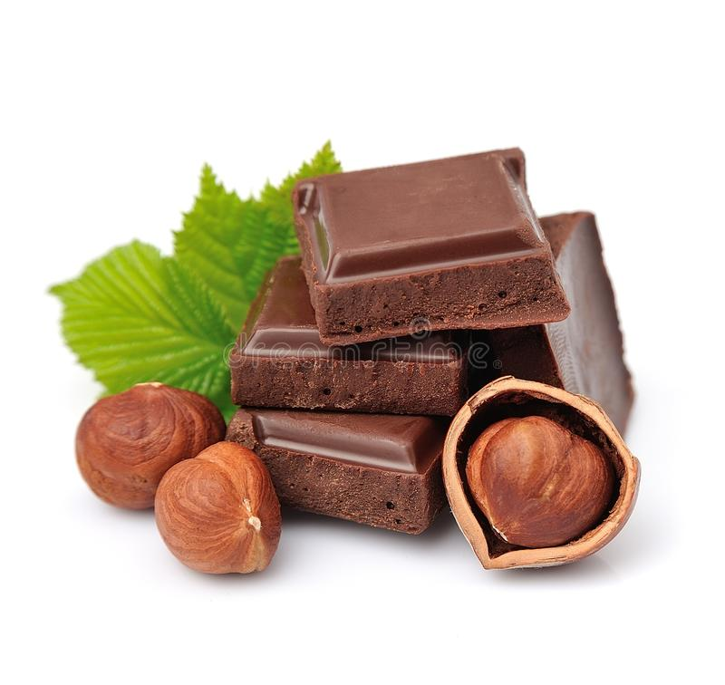 Chocolate with nuts. Chocolate with hazelnuts close up on white royalty free stock photos