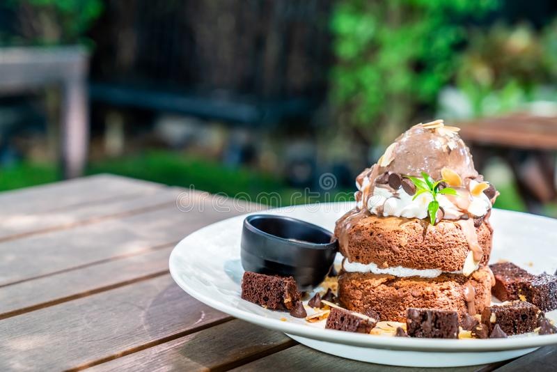 chocolate pancake with chocolate ice-cream and brownies royalty free stock photo