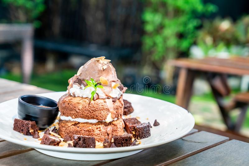 chocolate pancake with chocolate ice-cream and brownies royalty free stock image