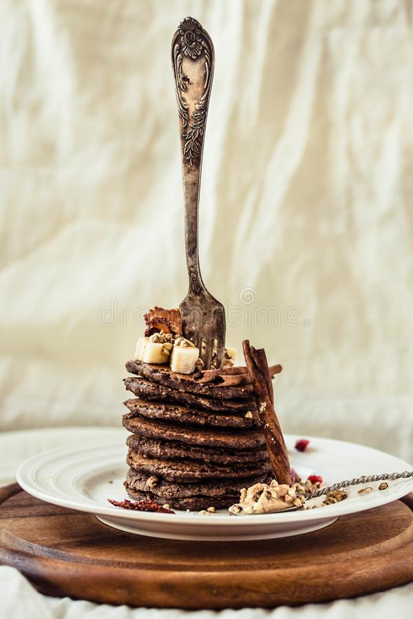 Chocolate pancakes with banana, peanut butter, green buckwheat a stock photo
