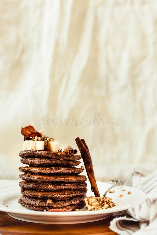 Chocolate pancakes with banana, peanut butter, green buckwheat a stock image