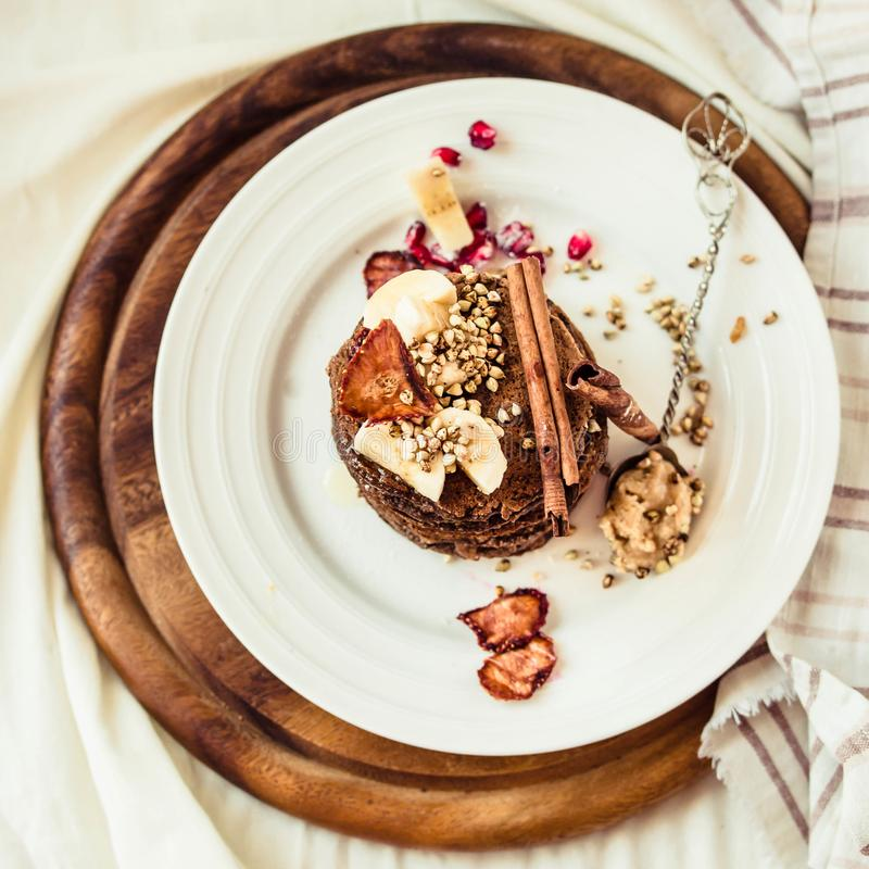Chocolate pancakes with banana strawberries. Glute stock photography