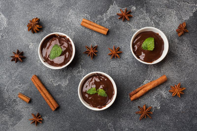 Chocolate paste with mint, cinnamon and anise on dark background with copy space stock images