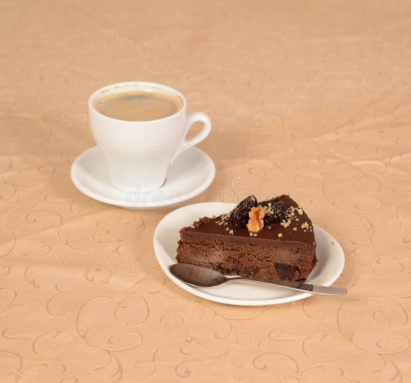 Chocolate pie with a cup of coffe stock photography