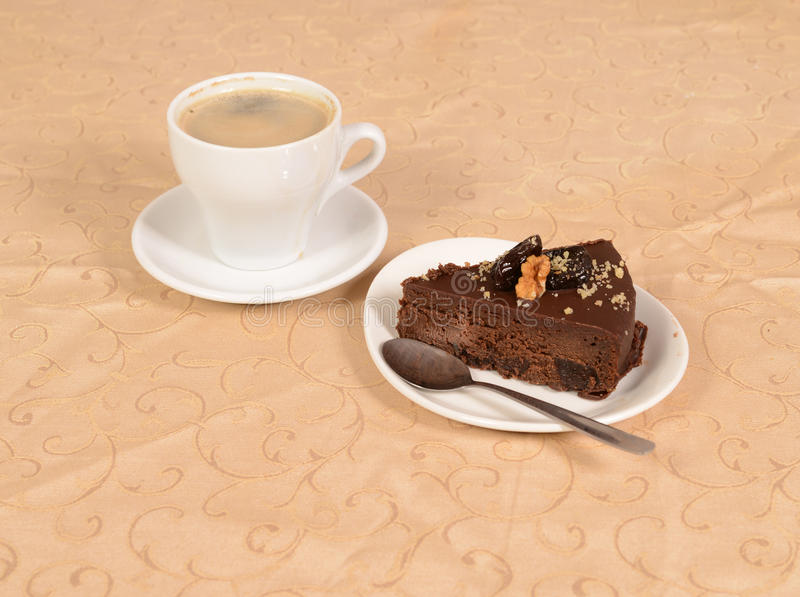 Chocolate pie with a cup of coffe royalty free stock photo