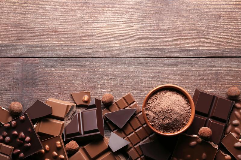 Chocolate pieces with cocoa powder royalty free stock images