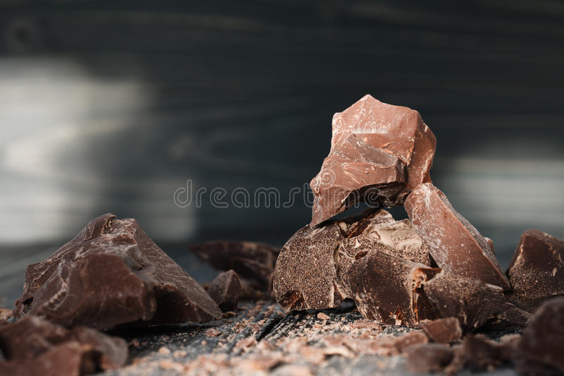 Chocolate pieces on a dark backround royalty free stock photo