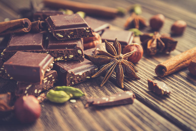 Chocolate pieces with sesame on a wooden table royalty free stock photography