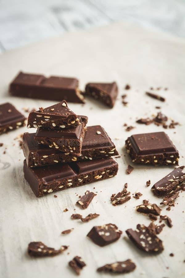 Chocolate pieces on a table stock photos