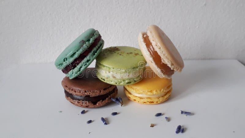 Chocolate, pistachio, vanilla macaron in background stock photos