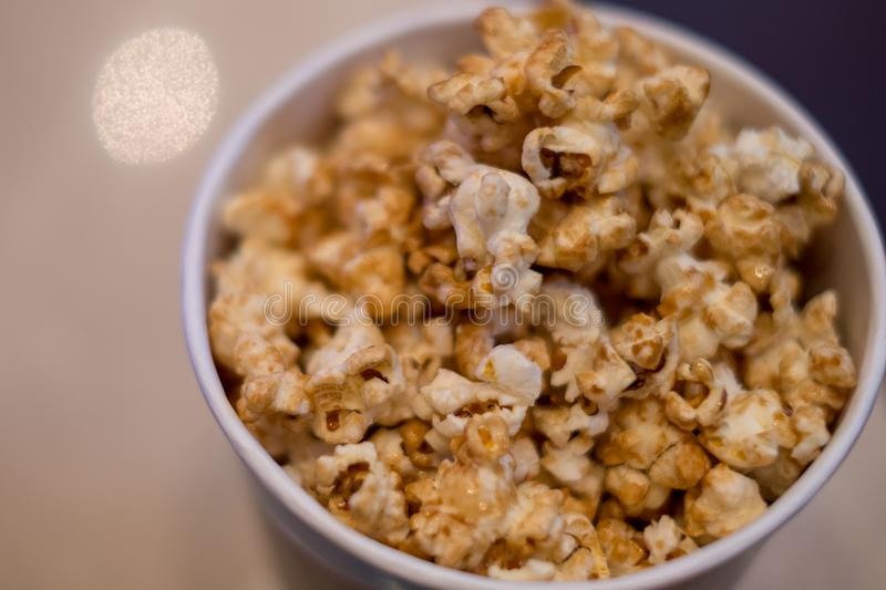 chocolate popcorn on blow ready for serve on movie time royalty free stock photo