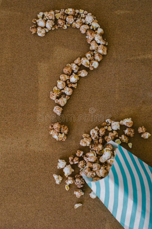 Chocolate Popcorn and Coffee with Marshmallows Cinema Concept Question Mark.  royalty free stock photo
