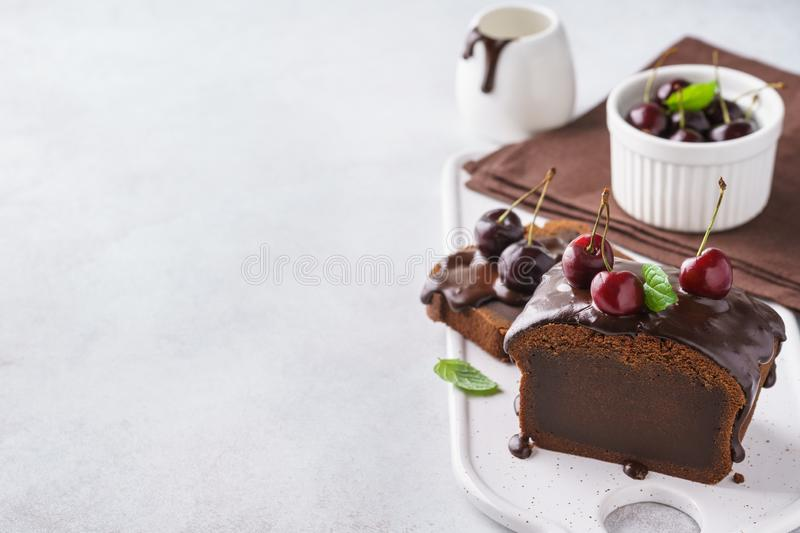 Chocolate pound cake for breakfast with glaze and fresh berries royalty free stock image