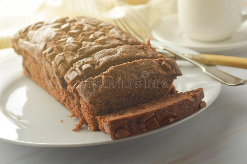 Chocolate pound cake. Homemade dark chocolate pastry for breakfast or dessert, bright background royalty free stock photos
