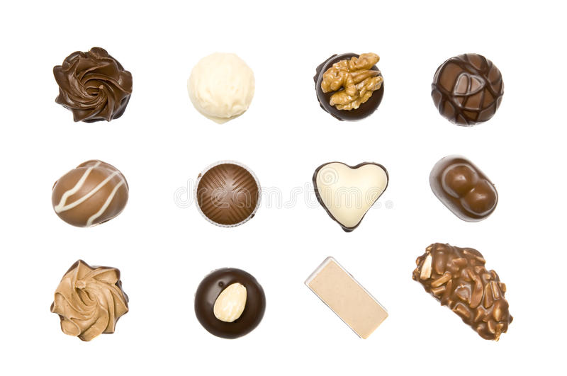 Chocolate pralines. Isolated on a white background stock photo