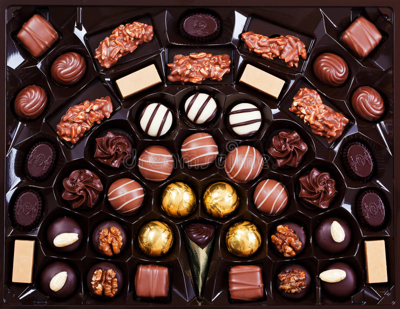 Chocolate pralines. Delicious chocolate pralines in a box stock images