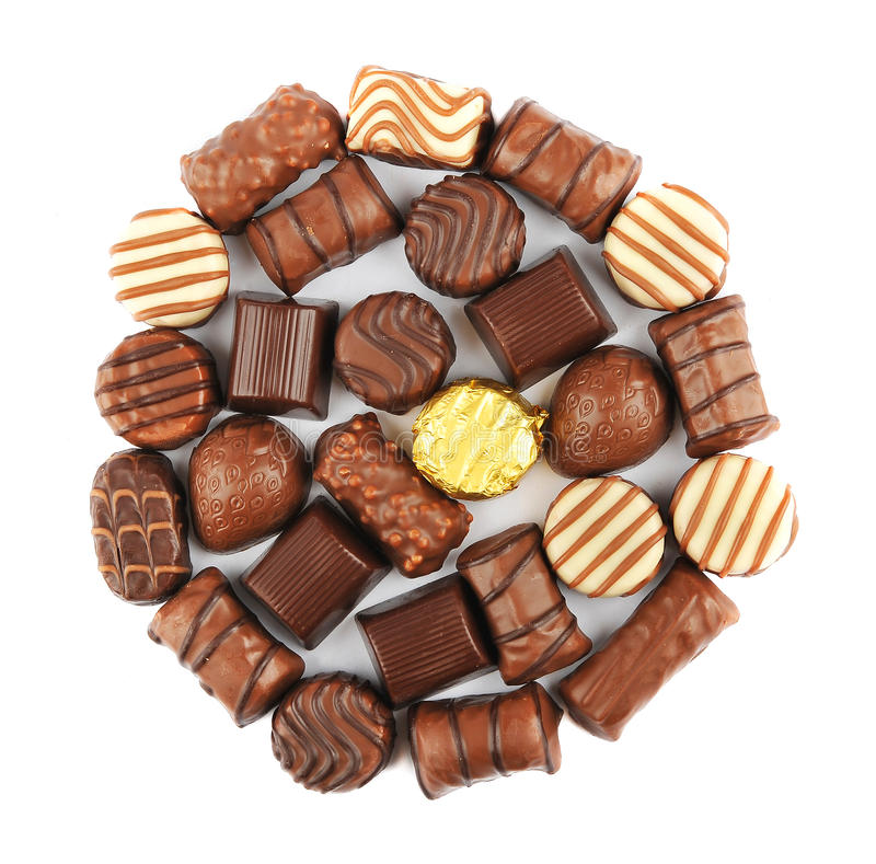 Chocolate Pralines. Close up of chocolate pralines isolated on a white background arranged in a circle stock photography