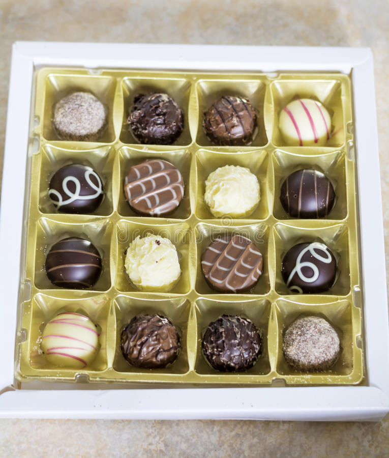 Chocolate pralines. Delicious chocolate pralines in a box stock image
