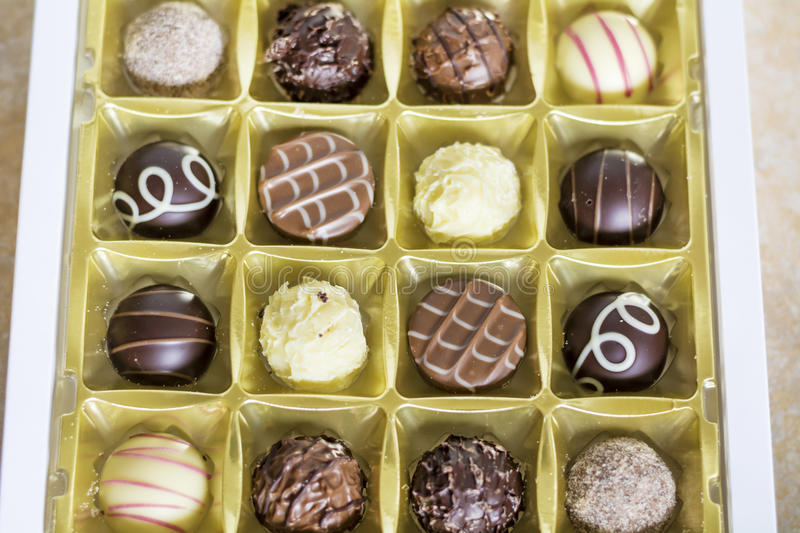 Chocolate pralines. Delicious chocolate pralines in a box royalty free stock photography