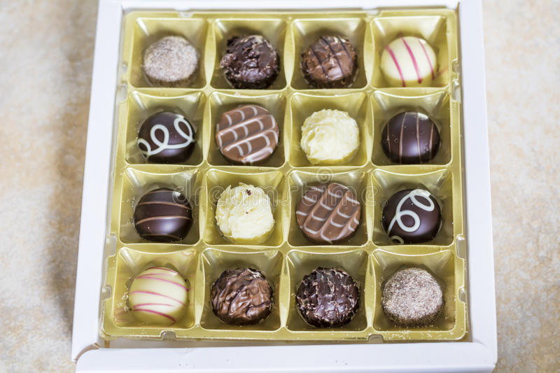 Chocolate pralines. Delicious chocolate pralines in a box royalty free stock images
