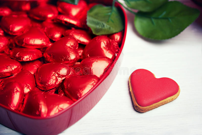 Chocolate pralines in red heart shaped gift box stock photography