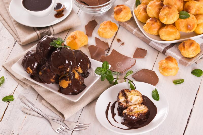Chocolate profiteroles. royalty free stock images