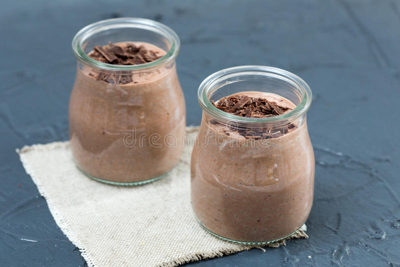 Chocolate pudding with chia seed, bananas and nuts, in a glass stock photos