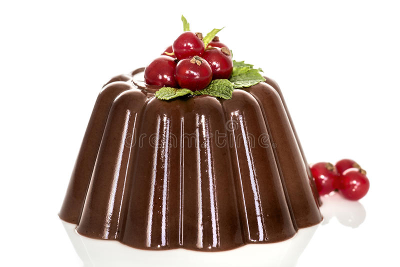 Chocolate pudding with red berries stock image
