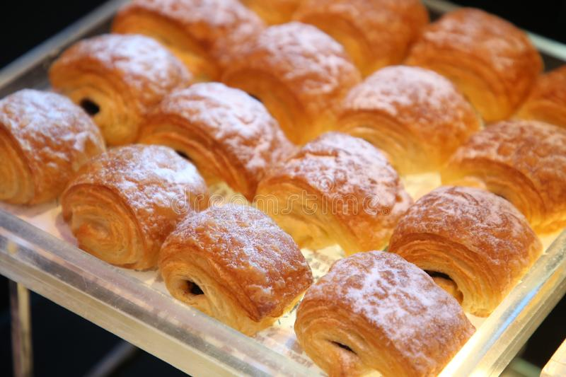 Chocolate puff pastry buns royalty free stock photos
