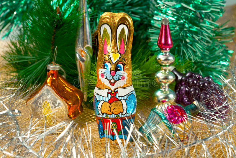 Chocolate rabbit and Christmas decorations royalty free stock photography