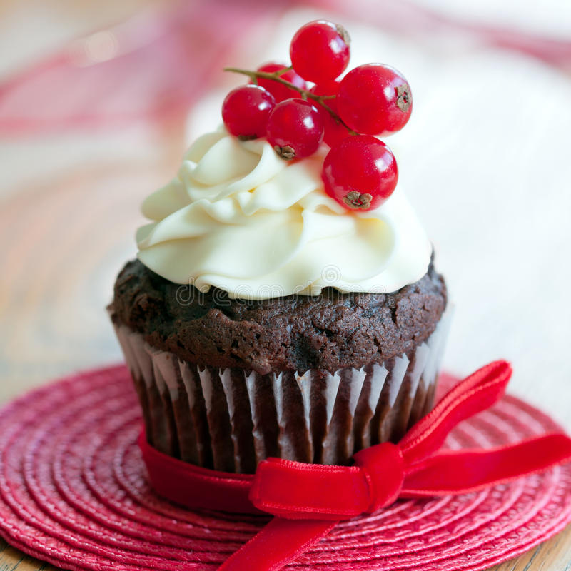 Chocolate and red berry cupcake stock photography