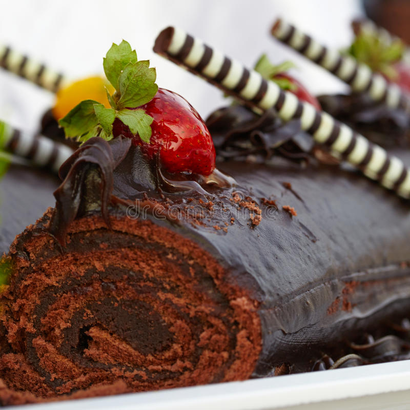 Chocolate roll cake with strawberries. See my other works in portfolio royalty free stock photos