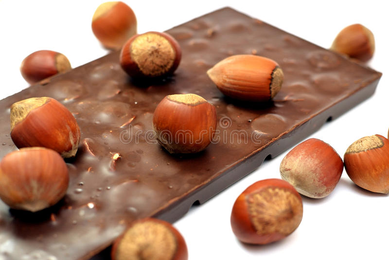 Chocolate saboroso com avelã foto de stock