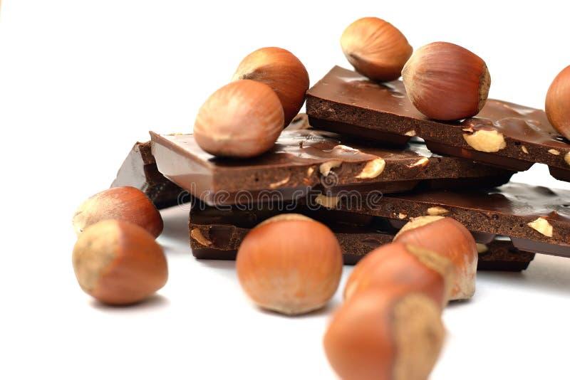Chocolate sabroso con las avellanas imagen de archivo