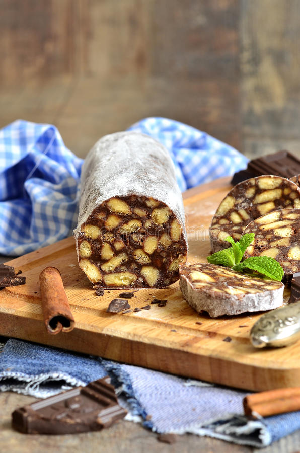 Chocolate salami with biscuits. stock photo