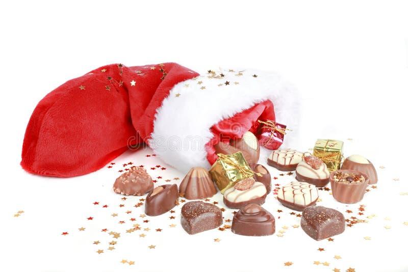 Chocolate And Santa Hat Royalty Free Stock Photos