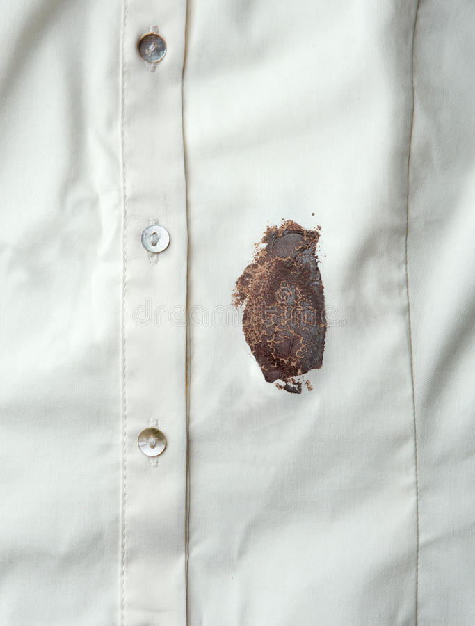 Chocolate sauce stain. On a shirt royalty free stock photos