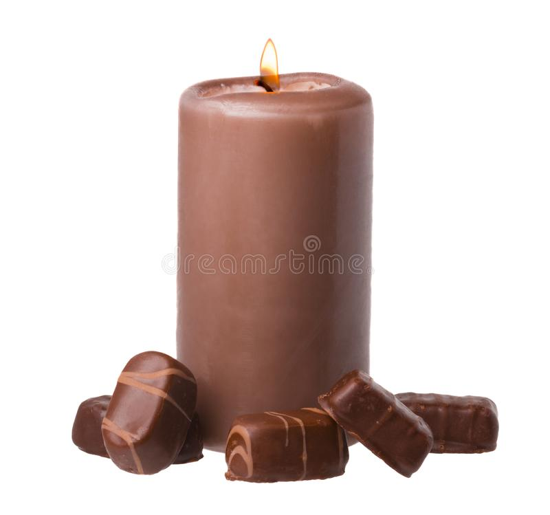 Chocolate Scented Candle with Chocolate Candies. On white Background royalty free stock photo