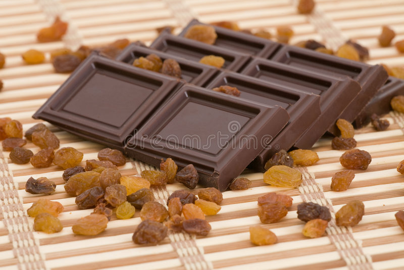 Chocolate slices with raisins stock photos