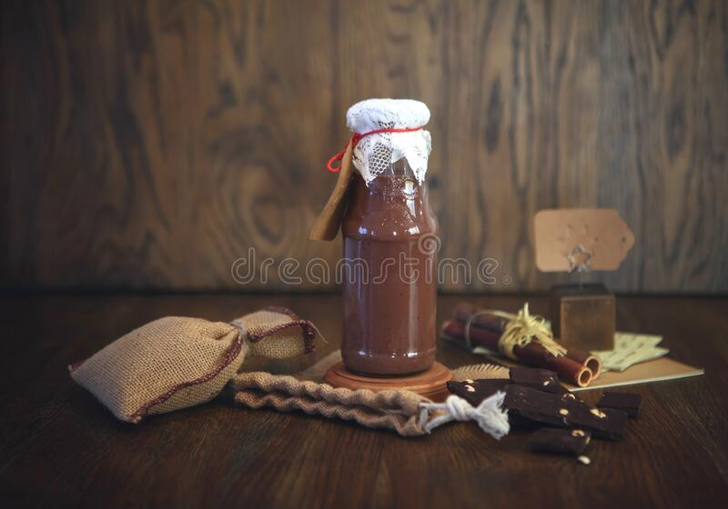 Chocolate Smoothie at the bottle. Colorful drink in bottle with organic chocolate and superfoods on a wooden background. Healthy,. Clean eating, vegan stock photo