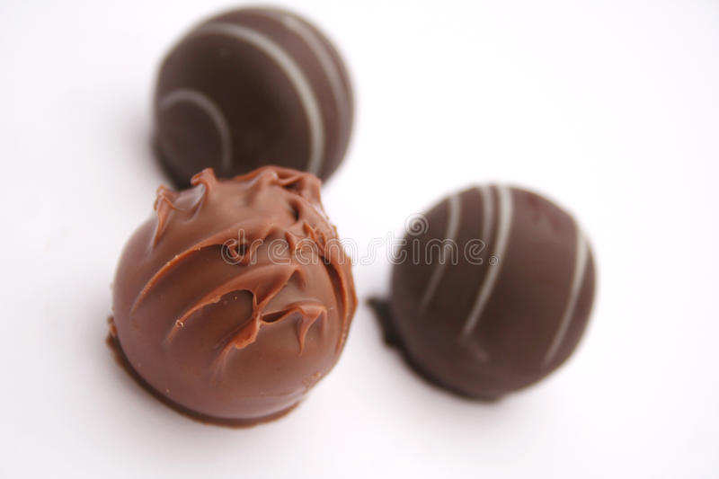 Chocolate. Some fine chocolate praline in different colours stock photos