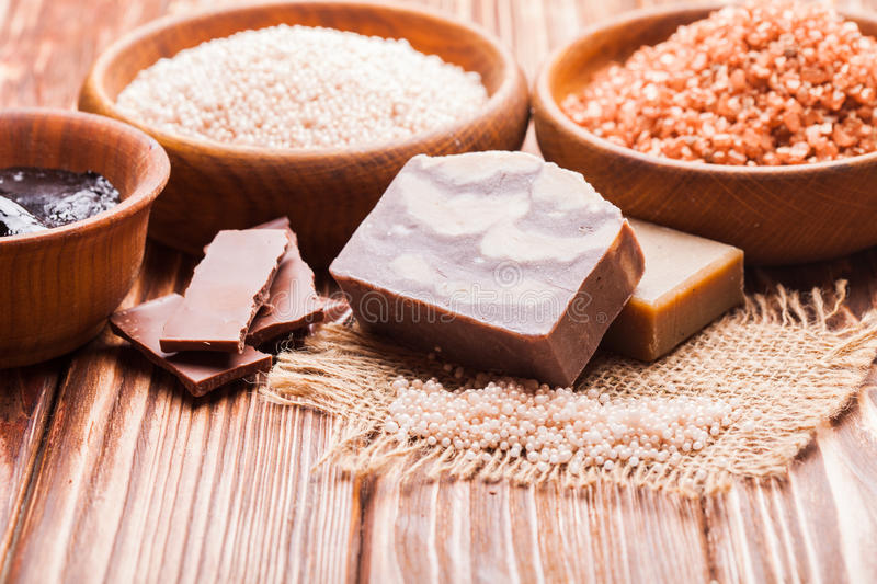 Chocolate spa set. Chocolate spa - sea salt, handmade soap and hot mask royalty free stock photography