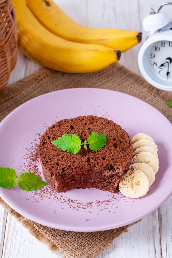 Chocolate Sponge Banana Cake with cocoa royalty free stock photography