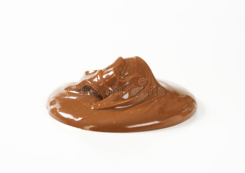 Chocolate spread. Blob of chocolate spread on white background royalty free stock image