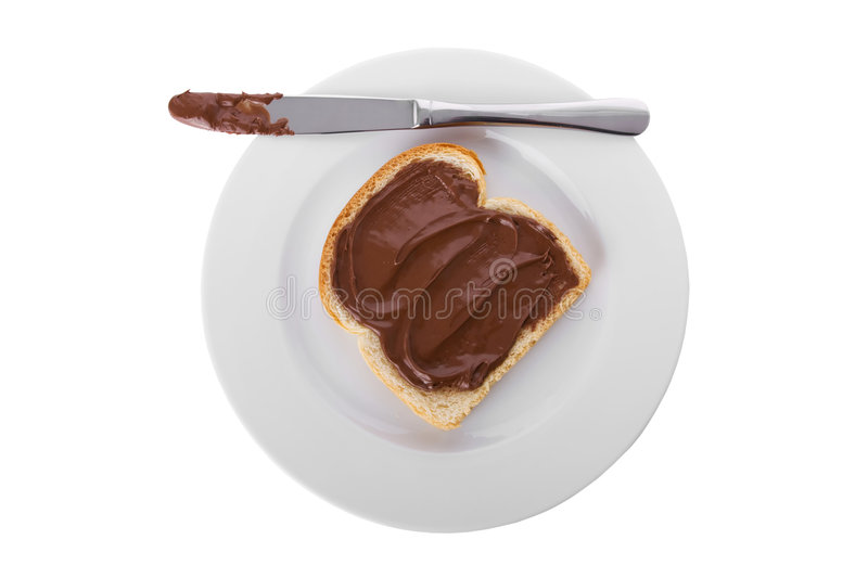 Chocolate spread over a slice of bread royalty free stock image