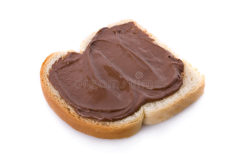 Chocolate spread on a slice of bread royalty free stock image